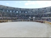 The performers leaving the arena after the Roman pantomime at Arènes de Nîmes